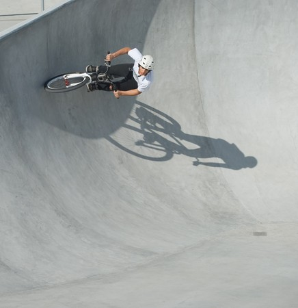 Riding the Wall at the Bike Park Stock Photo - 8090685
