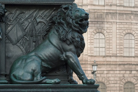 Lion on the Monument of Maximilian Joseph at the National Theater in Munich  photo