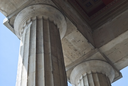 Two Classical Greek Columns from a Low Angled View photo