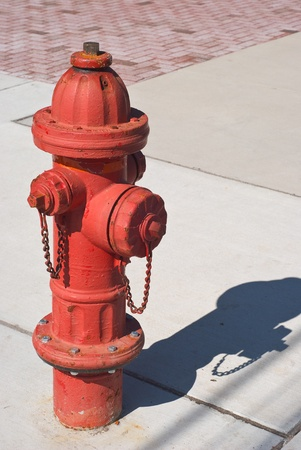 fire hydrant: Red Fire Hydrant on a City Sidewalk