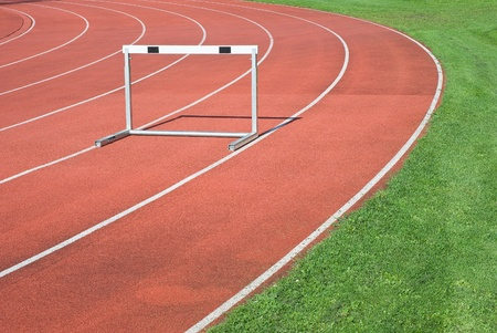 hurdle: Athletics as Symbol of  Personal Determination and Competitiveness   Stock Photo
