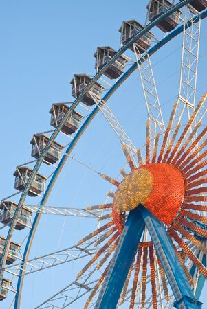 Large Ferris Wheel with Gondolas and Electric Lights photo