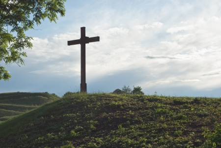 christian faith: Devotional Cross as Symbol of Christian Faith on Hill Stock Photo