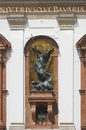 Saint Michael defeats Satan on Saint Michael Church in Munich Germany photo