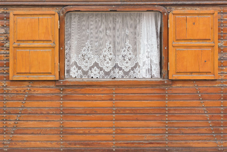 Window with Shutters on a Wooden House  in Germany photo