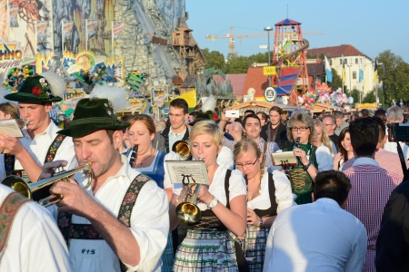 MUNICH, GERMANY  SEPT  21, 2013  Traditional Marching Band entertains Crowds of visitors at the annual Oktoberfest     The Festival runs from Sept  21 %uFFFD Oct  6  in Munich, Germany