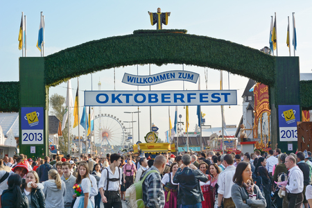 MUNICH, GERMANY  SEPT  21, 2013  Crowds of visitors at the annual Oktoberfest celebrating the opening day    The Festival runs from Sept  21  Oct  6  in Munich, Germany