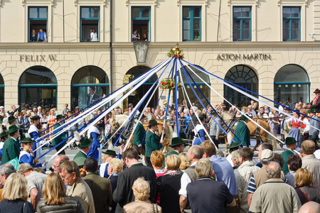 MUNICH, GERMANY – SEPT. 22, 2013: Traditional Oktoberfest Costume and Riflemens Parade entertains Crowds of visitors at the annual Oktoberfest. The Festival runs from Sept. 21 – Oct. 6  in Munich, Germany