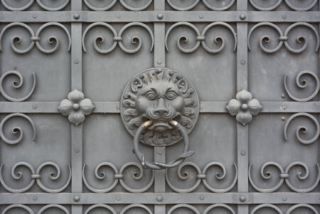 Lion Face on Wrought Iron Door at the Bavarian National Museum in Munich  photo