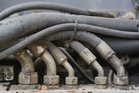hoses: Hydraulic Hoses with Connectors on Paving Equipment as Design Element