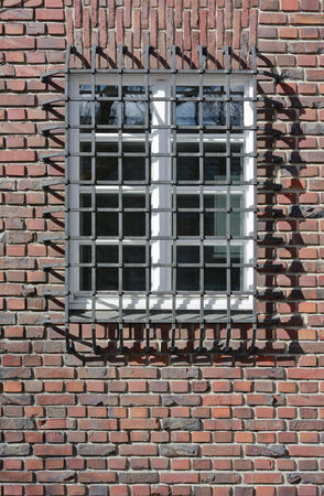 Brick Wall with Window Wrought Iron Guard