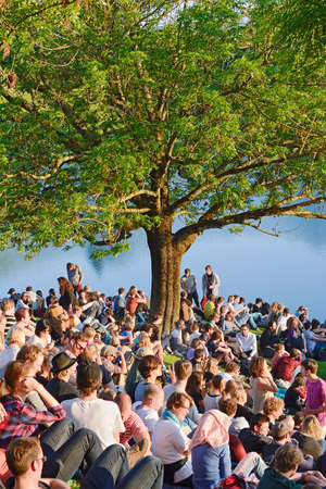 MUNICH, GERMANY � MAY 25, 2014:  After a long winter crowds of fans come out to a early summer music concert at the Olympic Park in Munich.
