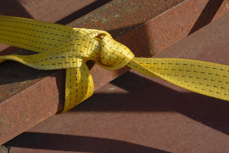 buckled: Yellow Industrial Strap for Protection and Security on Metal