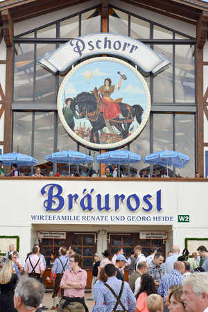 MUNICH, GERMANY - SEPT. 21, 2014:  Oktoberfest Crowds of visitors at the Hacker-Pschorr Tent celebrating the festivities. The Festival runs from Sept. 20 - Oct. 5  in Munich, Germany