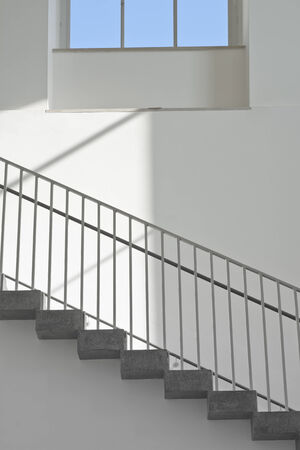 handrail: Stairs with Window as a Contemporary Architectural Element Stock Photo