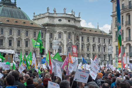 protest signs: MUNICH, GERMANY - April 18, 2015:  Protesters turn out in force to protest TTIP trade deal, the Transatlantic Trade and Investment Partnership, in Munich Germany. Editorial
