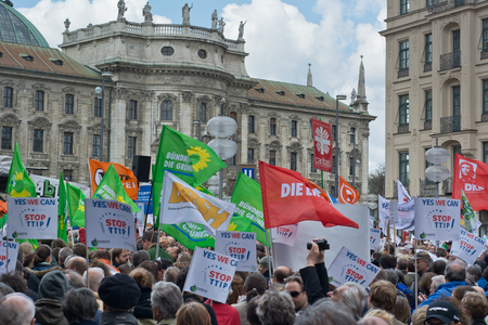 MUNICH, GERMANY - April 18, 2015:  Protesters turn out in force to protest TTIP trade deal, the Transatlantic Trade and Investment Partnership, in Munich Germany. Editorial
