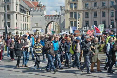 safety slogan: MUNICH, GERMANY - April 18, 2015:  Protesters turn out in force to protest TTIP trade deal, the Transatlantic Trade and Investment Partnership, in Munich Germany. Editorial