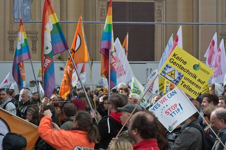 political and social issues: MUNICH, GERMANY -  April 18, 2015:  Protesters turn out in force to protest TTIP trade deal, the Transatlantic Trade and Investment Partnership, in Munich Germany. Editorial