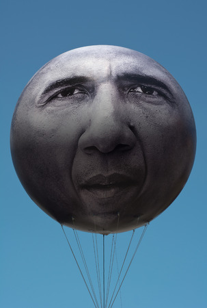 campaigning: MUNICH GERMANY  JUNE 5 2015:  ONE is an International Campaigning and Advocacy Organization. More Than Hot Air with giant President Obama Balloon is directed at the 2015 Summit Meeting in Germany.  The Campaign Balloon was installed on the Odeonsplatz in
