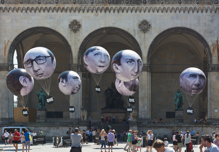bono: MUNICH GERMANY  JUNE 5 2015:  ONE is an International Campaigning and Advocacy Organization. More Than Hot Air with giant G7 Leader Balloons is directed at the 2015 Summit Meeting in Germany.  The Campaign Balloons are installed on the Odeonsplatz in Muni