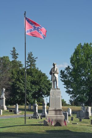 rebel flag: Confederate Soldier Monument with Flag in Frederick Maryland Cemetery