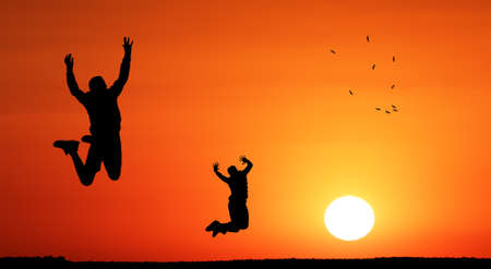 circling: Teenager children jumping into the sunset towards freedom. Birds circling the sky represent the freedom they looking for. Conceptual art Stock Photo