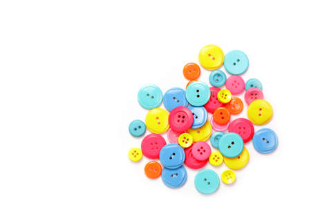 Colorful buttons stacked together on a white background