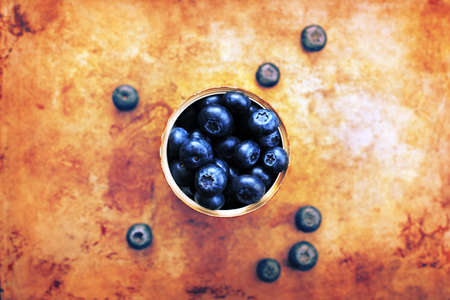 Creative blueberries on a rustic background.
