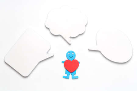 One human figure holding a heart with empty speech bubbles