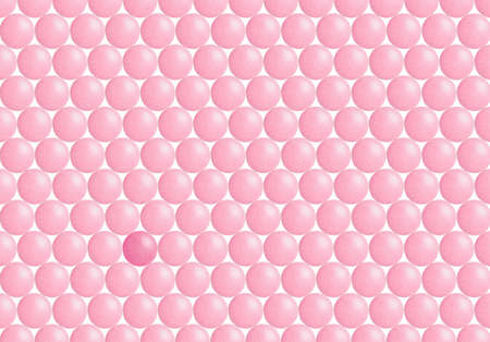 Pink coated chocolate circles with the odd one representing our daily life's