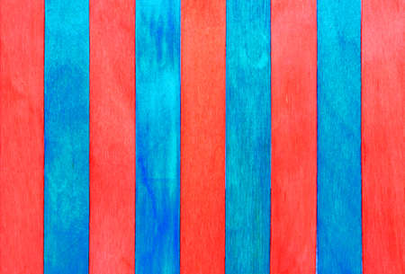 Red and blue striped wooden background