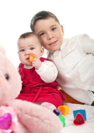 Children playing with toys in studio Stock Photo