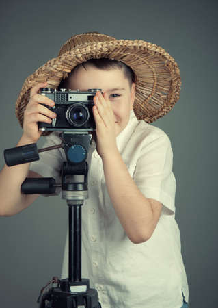 Boy with the  camera in studio Stock Photo
