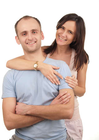 Young smiling couple in the studio white background Stock Photo - 14537238