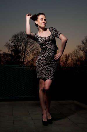 glamour girl in leopard dress outside