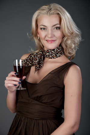 a girl with wineglass in studio photo