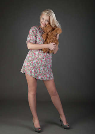 beautiful blonde woman holding teddy bear