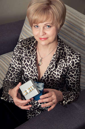 beautiful blonde woman holding box in hands Stock Photo