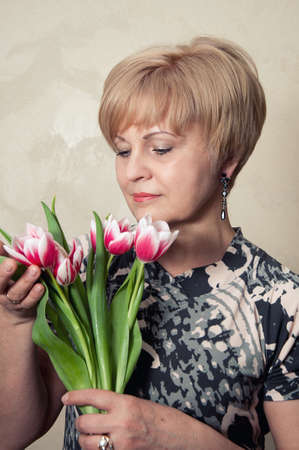 beautiful woman holding tulips in her hands
