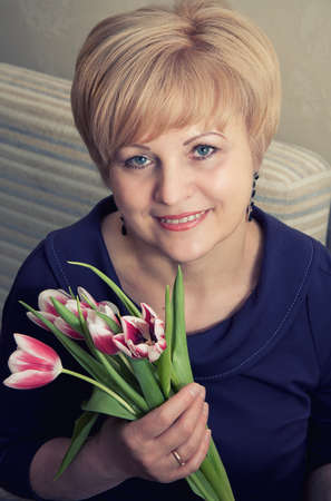 beautiful woman with flowers tulips