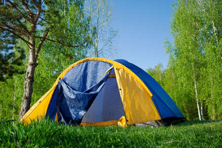 colourful Camping Tent in the forest outside Stock Photo