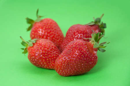 Strawberries  on green background
