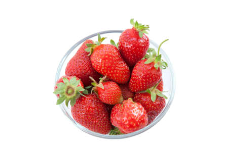 Fresh strawberries in a glass dish on white background