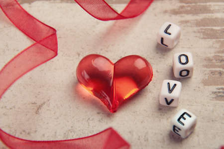 red heart on wooden board with a word love