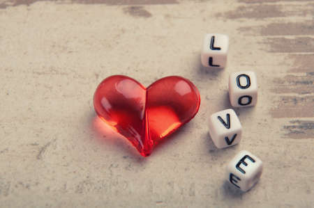 red heart on wood with a word love