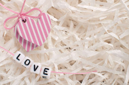 pink hearts on white paper with letters love Stock Photo