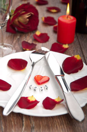 setting table for valentines day with petals