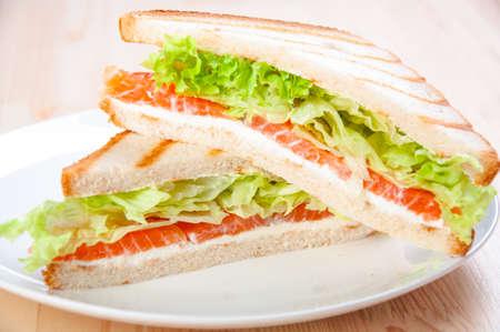 club sandwich with salmon, cheese, lettuce Standard-Bild