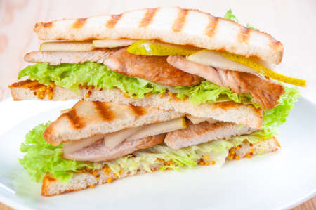 sandwich with turkey, cheese and vegetables, pears